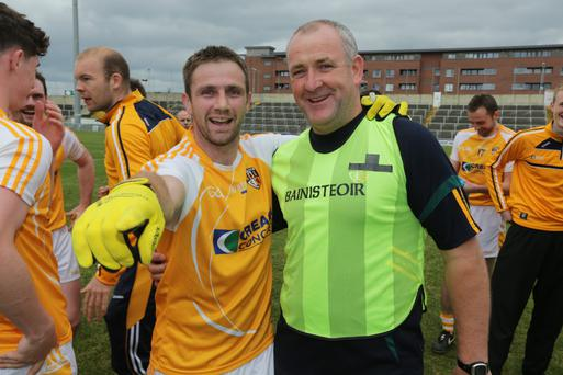 Happier times: Frank Fitzsimons (right) celebrates after Antrim's win over Laois at the weekend