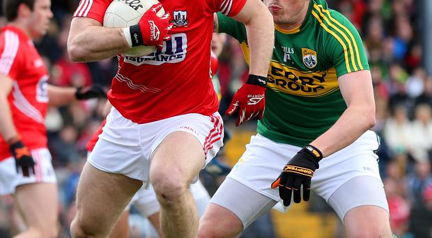 Close call: Cork's Michael Shields (left) and Kerry's Kieran Donaghy go head-to-head in classic clash
