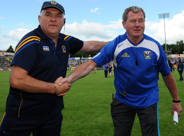 End game: Roscommon's John Evans and Terry Hyland of Cavan after the Rossies latest victory over the Ulster side