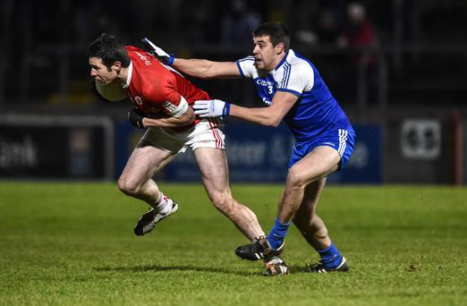 Getting to grips: Tyrone's Sean Cavanagh and Drew Wylie of Monaghan will meet again at Croke Park