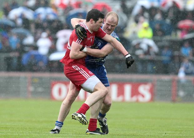 Bit of previous: Tyrone's Sean Cavanagh gets involved off the ball in an incident that led to the sending off of Monaghan's Dick Clerkin back in 2011