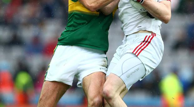 Up close: Colm Cavanagh takes on Kerry ace Anthony Maher