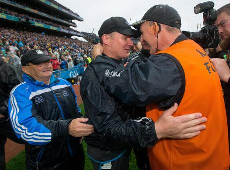 Over the line: Dublin manager Jim Galvin celebrates with selector Mick Deegan at the final whistle