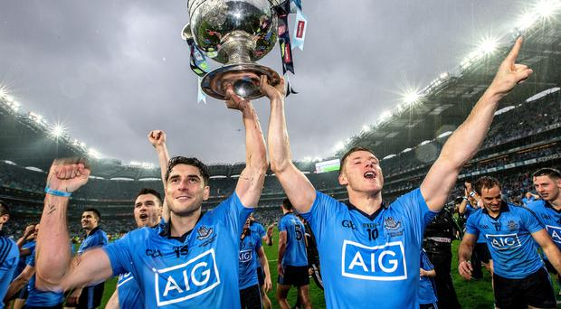 Silver lining: Dublin's Bernard Brogan andPaul Flynn celebrate after winning the All-Ireland Football Championship