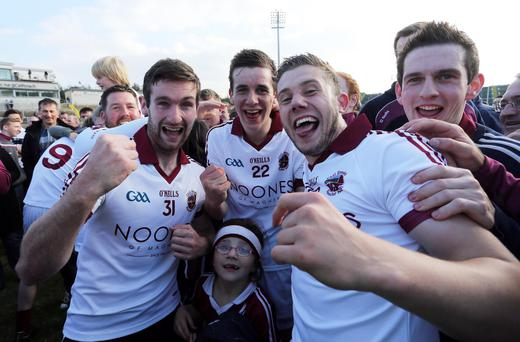We've done it: Slaughtneil players celebrate winning the Derry football title