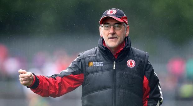 Face off: Tyrone manager Mickey Harte will stand in the way of new Derry boss Damian Barton in the Ulster Championship