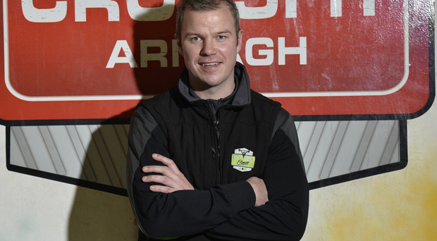Looking up: Ronan Clarke smiles at his gym, Clarke Fitness, outside Armagh city
