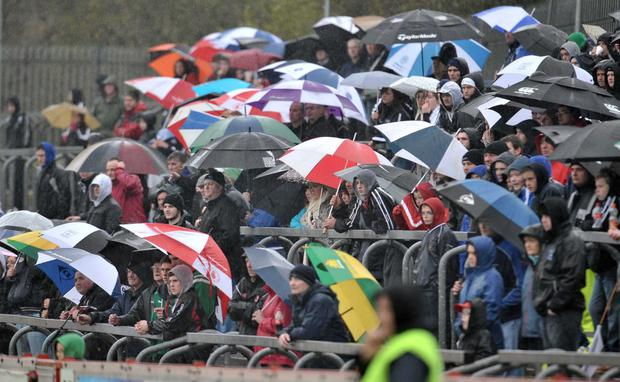 Weather watchers: The adverse conditions won't deter hardcore fans from attending O'Fiaich Cup games