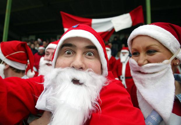 Time to deliver: Santa wears red so it must be a good omen for Tyrone and Derry fans for the big day