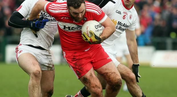 Off: Derry's Emmett McGuckin picked up two yellow cards