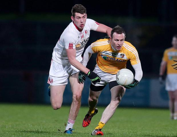 Up close: Antrim's Michael McCann under pressure from Padraig McNulty at Healy Park