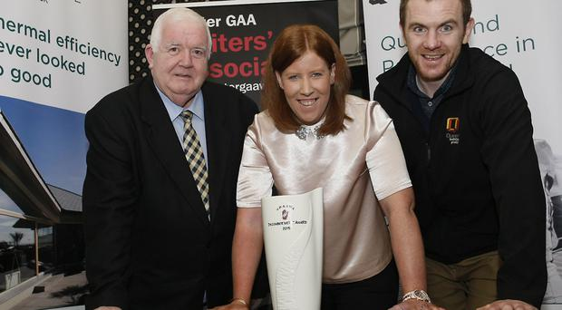 Net gains: Donaghmoyne ladies goalkeeper Linda Martin savours her Quinn Building Products Ulster GAA Writers' Association monthly award with Writers' vice-chairman John Graham (left) and ex-Fermanagh ace Martin McGrath of Quinn Building Products