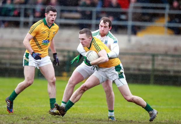 Tussle: Fermanagh's Sean Quigley with Conor McGill