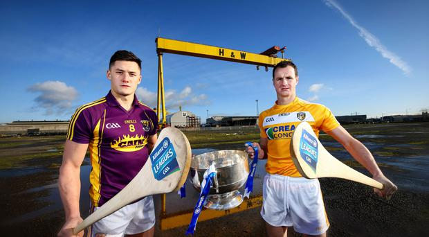 Hurl we go: Wexford's Lee Chin and Antrim's Liam Watson at the Belfast launch of the 2016 Allianz Hurling League at the H&W yard
