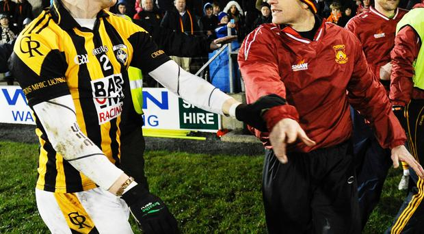 Stand-off: Castlebar co-manager Declan Shaw (right) and Paul Hughes of Crossmaglen tangle