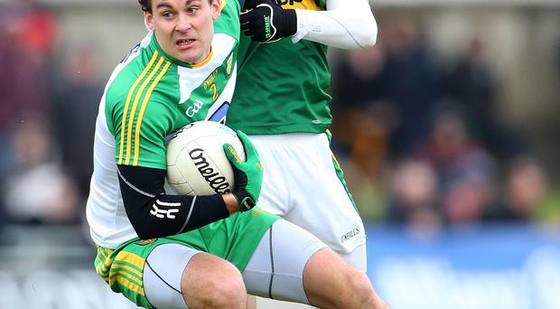 Gripping: Kerry's Darran O'Sullivan with Eamon McGee