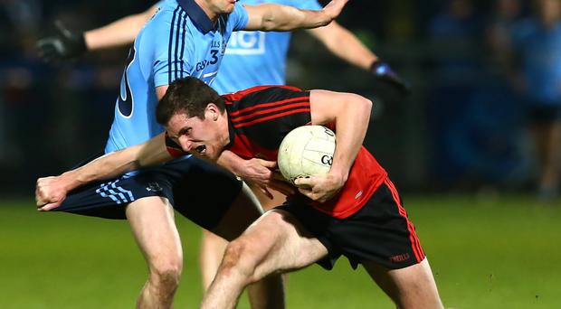 No way through: Down's Jonny Flynn finds his route blocked by Dublin's Eric Lowndes at Pairc Esler