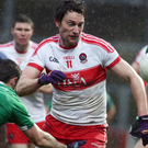 Last gasp: James Kielt levelled for Derry in injury time