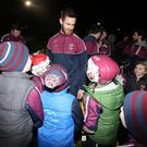 Role model: Neil McManus chats to young supporters