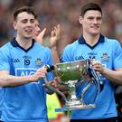 Prize guys: Dublin's Cormac Costello and Diarmuid Connolly with the Sam Maguire Cup