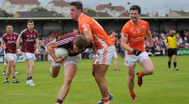 Knockout blow: Armagh lost to Galway in the qualifiers last year and now the Orchard men and Derry's Damian Bartonface a nervous weekend