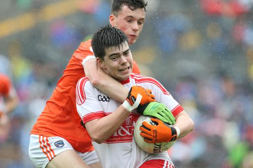 Gripping: Simon McElain of Derry wrestles with Cathair McGear