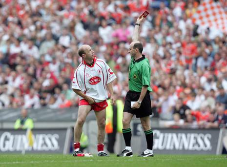 Second chance: Peter Canavan of Tyrone is sent off by referee Micheal Collins in the 2005 Ulster Final replay defeat by Armagh at Croke Park but the Red Hands bounced back later in the year as Mickey Harte got his hands on the Sam Maguire Cup