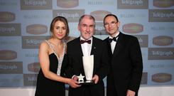 Fame game: Mickey Harte receives his Belfast Telegraph Sports Award Hall of Fame trophy from Martin O'Neill and Belleek Living's Rachael Weir