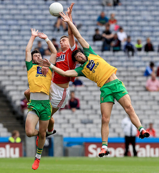 Running on empty: Donegal and Cork battle it out at a sparcely populated Croke Park