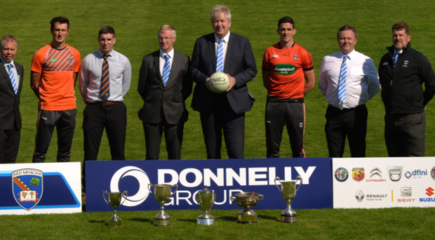 Deal us in: Donnelly motor group Armagh club championship sponsorship launch with, from left, Malcolm Kerr, Managing Director Donnelly Group, Stephen Sheridan and Brian Mallon, Armagh GAA, Geoffrey Lamont and Raymond Donnelly, Donnelly Group, Rory Grugan, Armagh GAA, Seamus McAlinden and David Crawford, Donnellys