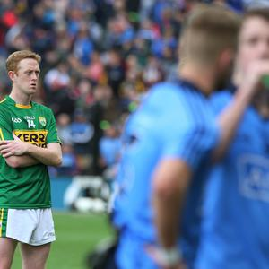 Out for revenge: Dublin players celebrate as Killian Young of Kerry sits dejected at the end of last year's All-Ireland Final