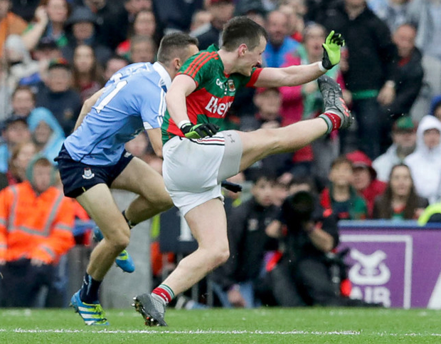 Final say: Mayo's Cillian O'Connor slots over the equalising point