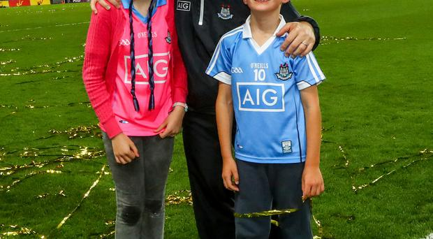 Top man: Jim Gavin celebrates with his children Jasmine and Jude