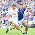 In the running: Peter Harte of Tyrone, who has been nominated for an All Star, jostles with Cavan's Killian Clarke in the Ulster Senior Championship semi-final replay