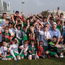 Stars of the east: A group of children, who had played in games earlier, with GAA President Aoghan ÓFearghail and the Sam Maguire Cup prior to the GAA GPA All-Stars football tour sponsored by Opel at the Sheikh Zayed Sports City Stadium in Abu Dhabi, United Arab Emirates