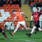 Hotshot: Man of the match Rory Grugan helps himself to four points against Down in the McKenna Cup