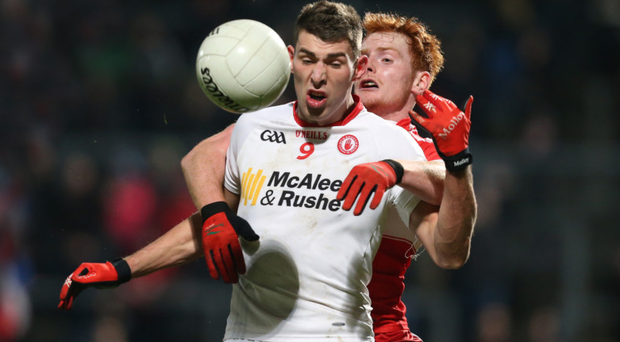 Close control: Padraig McNulty of Tyrone battles with Conor McAtamney