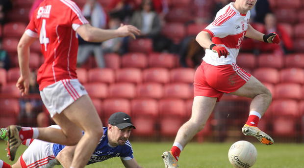 Hitting the target: Derry's Danny Tallon scores a goal against Cork