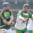 Closed down: Antrim's Paddy McGill clashes with Donegal's Danny Cullen during the semi-final battle