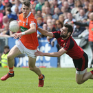 My ball: Down's Kevin McKernangets to grips with Armagh's Paul Hughes