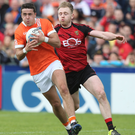 Tight tussle: Down's Gerard McGovern and Stefan Campbell