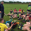 Calling the shots: All-Ireland winner Liam Sheedy talks to the Antrim squad that will embark on an All-Ireland mission