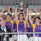 Roaring success: Derrygonnelly's captain Ryan Jones hoists the New York Cup aloft as he and his team celebrate