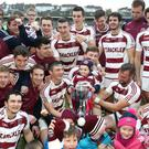 Champions: the victorious Slaughtneil team with their trophy