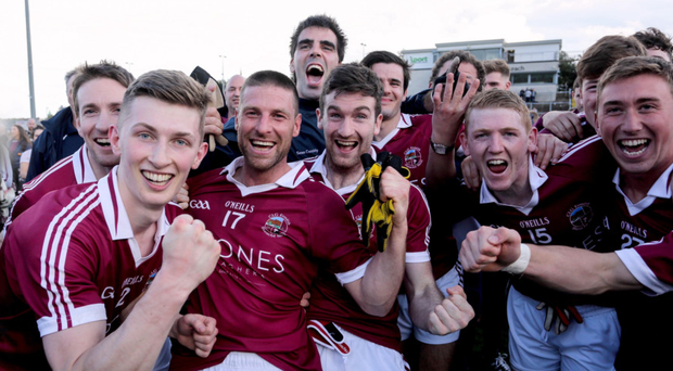 Success story: Slaughtneil celebrate Derry title triumph against Ballinascreen