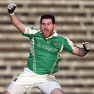 Get in: Seamus Quigley celebrates bagging the decisive score for Fermanagh against Queen's at Brewster Park yesterday