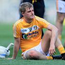 Game in slump: Antrim's Eoghan Campbell is dejected after defeat to Carlow in last year's Christy Ring Cup Final at Croke Park