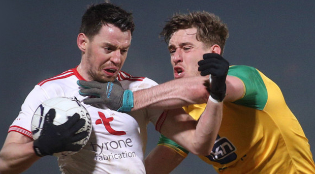 Pitch battle: Tyrone's Matthew Donnelly and Donegal's Hugh McFadden grapple for possession
