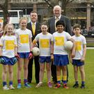 Big launch: Antrim chairman Colin Donnelly (left), GAA president John Horan (right) and players from St Brigid's