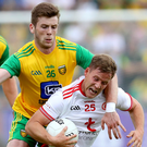 Striding on: Kieran McGeary breaks clear during Tyrone's late show against Donegal